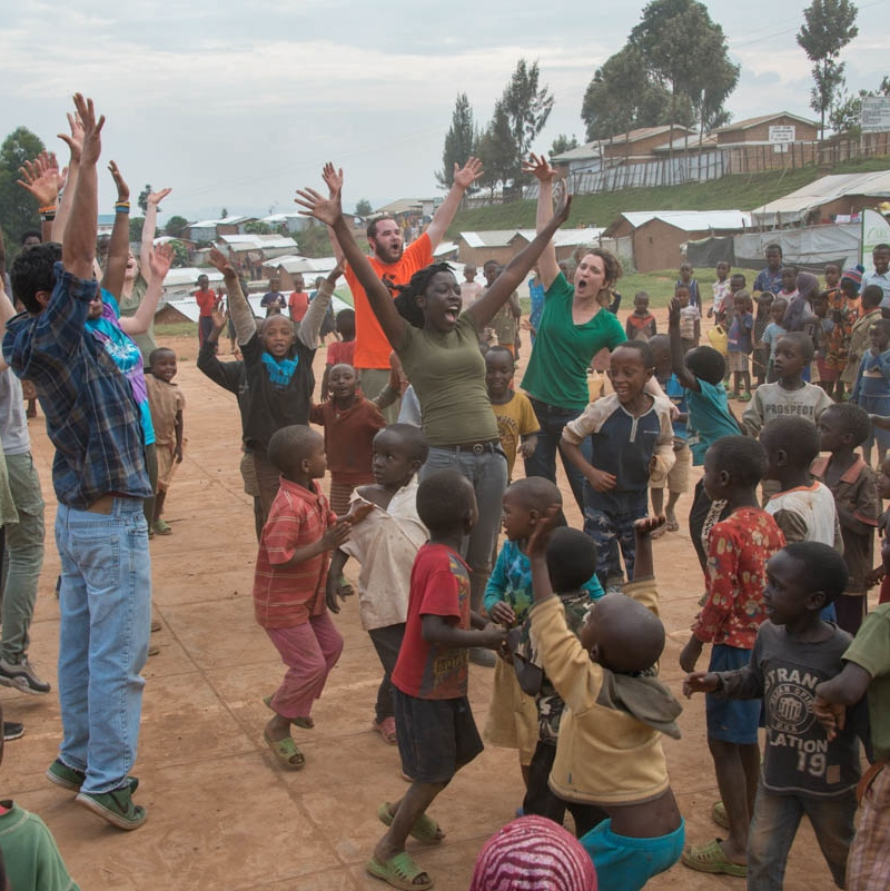 Students and children dancing