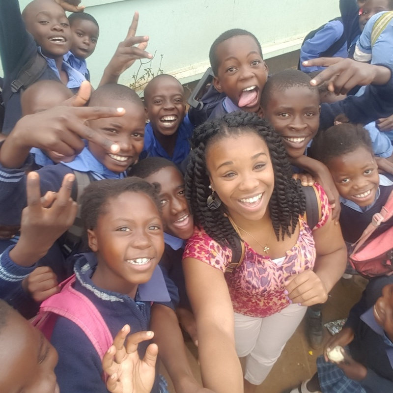Students and children smiling